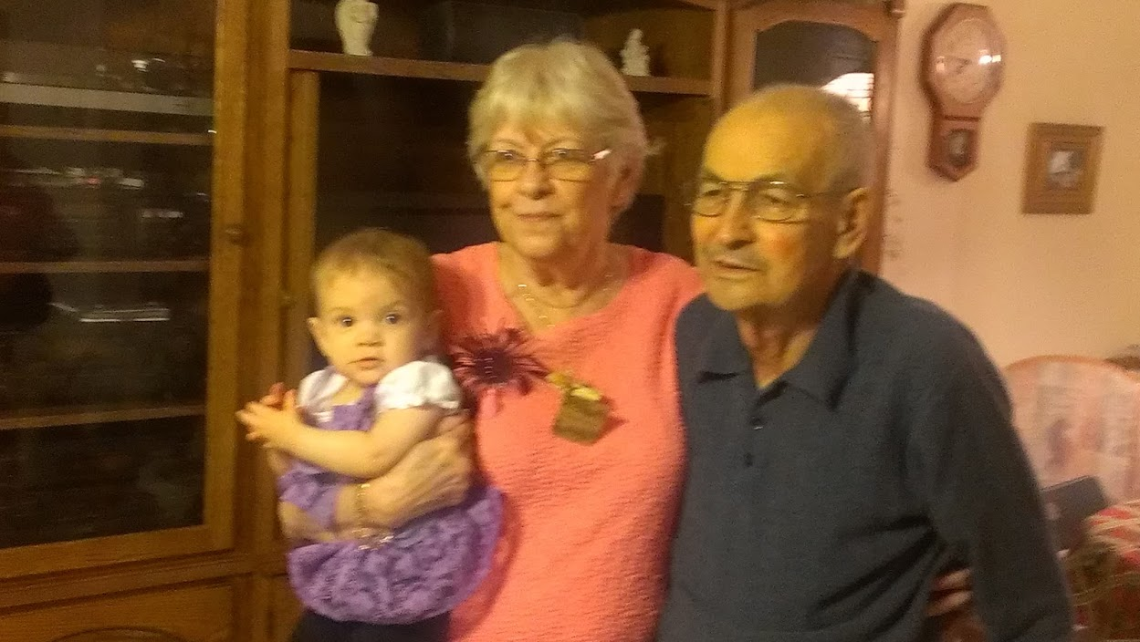 My mom and dad and grand daughter in 2012.